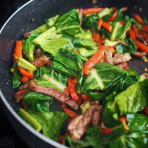 wilted veggies for hoisin beef noodles